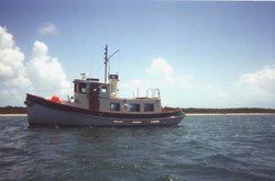 17%20tug%20at%20anchor%20pg57.jpg